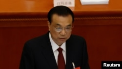 Chinese Premier Li Keqiang speaks at the opening session of the National People's Congress (NPC) at the Great Hall of the People in Beijing, China March 5, 2021.