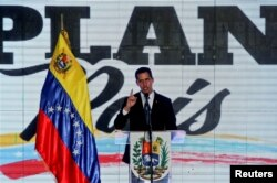 FILE - Venezuelan opposition leader Juan Guaido, who many nations have recognized as the country's rightful interim ruler, speaks during a meeting regarding the condition of the water and electricity systems in Caracas, Venezuela, March 28, 2019.
