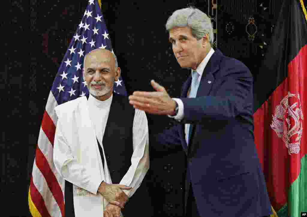 U.S. Secretary of State John Kerry meets with Afghanistan's presidential candidate Ashraf Ghani Ahmadzai at the U.S. Embassy in Kabul, July 11, 2014.