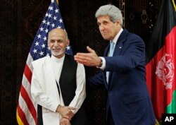 FILE - Kerry meets with Afghanistan's presidential candidate Ashraf Ghani Ahmadzai at the U.S. Embassy in Kabul, July 11, 2014.