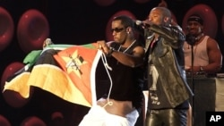 "U.S. superstar, Sean ""P Diddy"" Combs, left, was joined by South African Kwaito musician Mandoza at a concert in Cape Town South Africa, November 23, 2002."