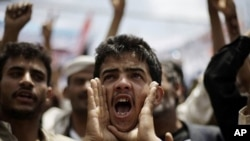 A protester shouts slogans during a demonstration to demand the resignation of Yemen's President Ali Abdullah Saleh in Sanaa, Yemen, Sept. 29, 2011.