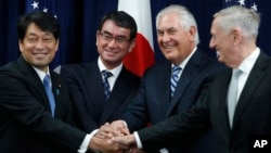 "From left, Japanese Defense Minister Itsunori Onodera, Japanese Foreign Minister Taro Kono, Secretary of State Rex Tillerson and Defense Secretary James Mattis shake hands ""ASEAN style"" at the start of a Security Consultative Committee meeting at the State Department in Washington, Aug. 17, 2017."