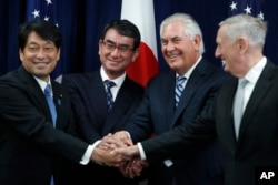 "From left, Japanese Defense Minister Itsunori Onodera, Japanese Foreign Minister Taro Kono, Secretary of State Rex Tillerson and Defense Secretary James Mattis shake hands ""ASEAN style"" at the start of a Security Consultative Committee meeting at the Stat"