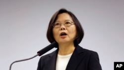 "FILE - Beijing has stopped official communication with self-ruled Taiwan because DPP leader and President Tsai Ing-wen refuses to acknowledge the ""one China"" principle."