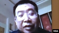 刚获释的中国维权律师江天勇(金变玲微信视频截图)
