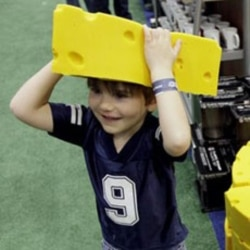 Henry Moser, 5, of McKinney, Texas, tries on a cheesehead at the NFL Shop in Dallas