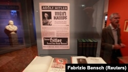 "Copies of Adolf Hitler's book ""Mein Kampf"" (My Struggle) are pictured at the media preview of ""Hilter und die Deutsche Volksgemeinschaft und Verbrechen"" (Hitler and the German Nation and Crime) at the Deutsche Historisches Museum (German Historical Museum"