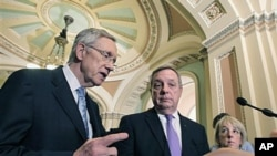 Senate Majority Leader Harry Reid, D-Nev., (L), joined by Majority Whip Dick Durbin D-Ill., (C), and Sen. Patty Murray, D-Wash., (R), speaks to reporters following a budget vote late in the day, at the Capitol in Washington, DC, May 25, 2011