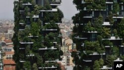 "The twin towers of the Bosco Verticale (Vertical Forest) residential buildings at the Porta Nuova district rise above Milan, Italy, on Aug. 3, 2017. Designed by the Boeri studio, it was named ""2015 Best Tall Building Worldwide"" by the Council on Tall Buildings and Urban Habitat. Boeri has plans to make ""forest cities"" in China and elsewhere."