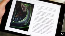 "Text and an illustration from ""Harry Potter and the Chamber of Secrets"" are displayed on an iPad, Sept. 30, 2015, in New York."