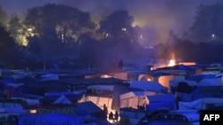 Migran nan kan ki rele Jungle nan Calais an Frans, 24 oktòb, 2016