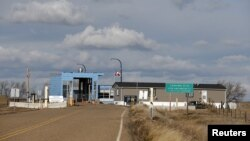 A Canadian customs building is seen from the United States Border Station Port of Willow Creek on the international border in Montana, United States, Nov. 20, 2015.