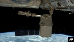 This photo released by NASA shows the SpaceX Dragon undocked from the International Space Station as it is maneuvered for its release, May 11, 2016.