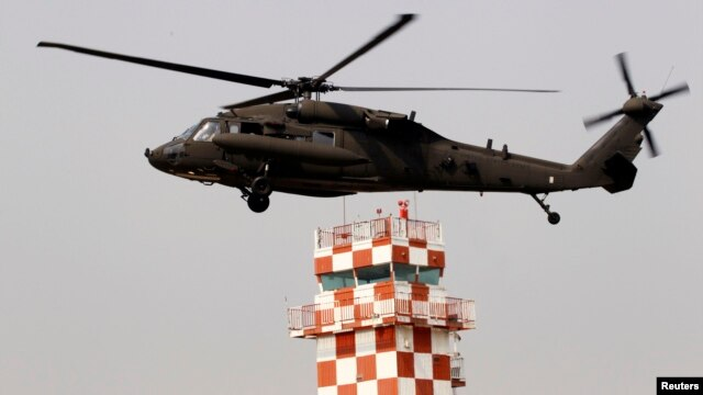 A U.S. Army helicopter prepares to land after a ceremony givng notice of the official return of the U.S. Army's 23rd chemical battalion to South Korea, Uijeongbu, April 4, 2013.