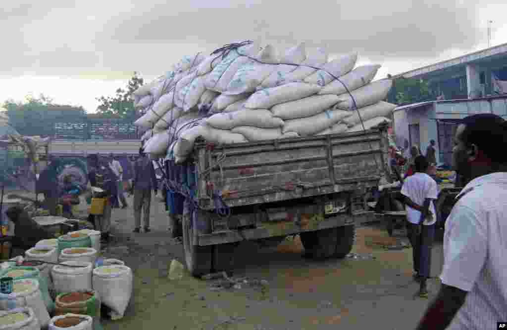 SOMALIA: Even stolen food aid is delayed by bad roads near the capital of Somalia as in this photograph taken by AP on Aug. 8, 2011.