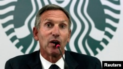 Starbucks Chairman and CEO Howard Schultz speaks during a news conference at a hotel in Bogota, Aug. 26, 2013.