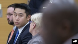 Police officer Peter Liang, second from left, sits with his legal team in his trial on charges in the shooting death of Akai Gurley at Brooklyn Supreme court in New York, Feb. 11, 2016.