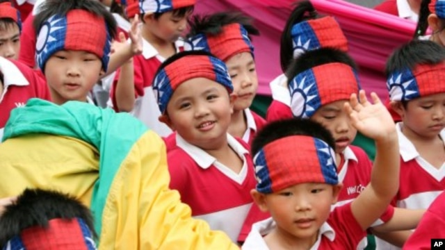 Young performers participate in the national day celebrations of the centennial anniversary of the founding of the Republic of China government in Taipei, Taiwan, October 10, 2011.