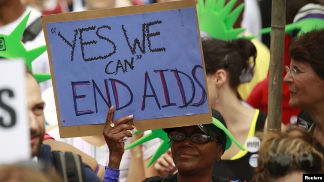 AIDS activists take part in a rally across from the White House in Washington, D.C., where the international AIDS 2012 conference is currently being held, July 24, 2012.