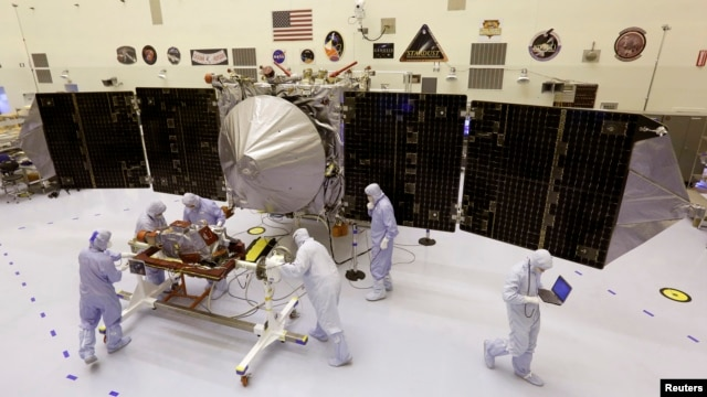 Technicians work on NASA's next Mars-bound spacecraft, the Mars Atmosphere and Volatile Evolution (MAVEN) spacecraft, as it is displayed for the media at the Kennedy Space Center in Cape Canaveral, Florida September 27, 2013. MAVEN is the first spacecraft