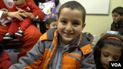 The gift he received put a big smile on this Syrian boy's face.
