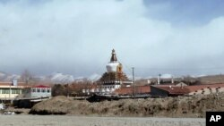 In this photo taken on Monday, Feb. 27, 2012, Stupa of Kirti monastery, the largest Tibetan monastery is seen in Aba prefecture, in China's Sichuan province. China's stifling lockdown of this Tibetan monastery town has not only been about patrolling its o