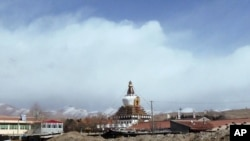 In this photo taken on Monday, Feb. 27, 2012, Stupa of Kirti monastery, the largest Tibetan monastery is seen in Aba prefecture, in China's Sichuan province.