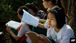 FILE - Students prepare for an exam in suburbs of Yangon, Myanmar, Feb. 19, 2016.