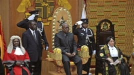 Former Ghanaian Vice President John Mahama is seated after being sworn in as President, July 24, 2012.
