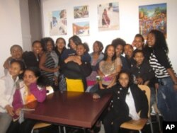 Young people visit an Ethiopian art exhibition during a summer camp field trip sponsored by the Ethiopian Community Center in Seattle.