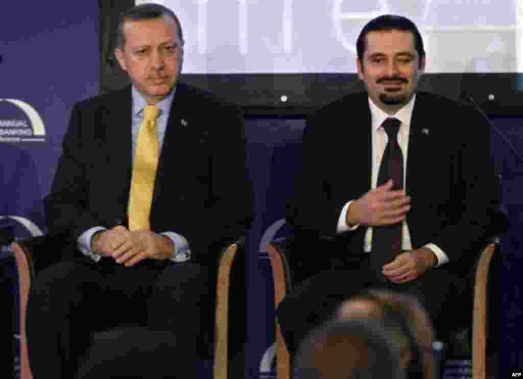 Lebanese Prime Minister Saad Hariri, right, and his Turkish couterpart Recep Tayyip Erdogan, left, attend the Union of Arab Banks annual meeting in Beirut, Lebanon, Thursday, Nov. 25, 2010. Bank deposits in the Arab world are on track to grow over 40 perc