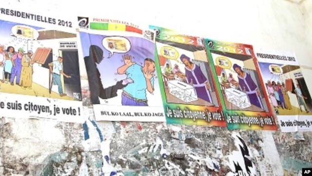 Posters encourage citizens to vote. The second to the left tells people not to accept bribes from political campaigners in exchange for votes, January 23, 2012