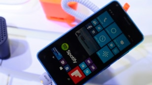 A beach mat designed by a Lebanese student can charge a cell phone, like this Microsoft Lumia 640 smartphone.