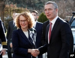 NATO Secretary-General Jens Stoltenberg is welcomed by Macedonian Defense Minister Radmila Sekerinska Jankovska upon his arrival at the Defense Ministry in Skopje, Macedonia, Jan. 19, 2018.