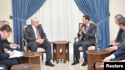Syria's President Bashar al-Assad (CR) meets Russian deputy Foreign Minister Sergei Ryabkov (CL) in Damascus, Sept. 18, 2013.