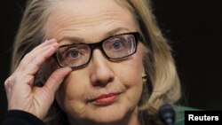 U.S.Secretary of State Hillary Clinton adjusts her glasses before testifying on the attack in Benghazi, Libya, during a hearing congressional hearing on Capitol Hill in Washington, January 23, 2013.
