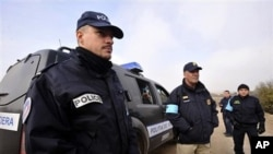 Frontex Police officers stay near the border with Turkey as they are deployed to help Greek border police control crossing of illegal immigrants to Greece and Europe near Nea Vyssa, northeastern Greece (file)