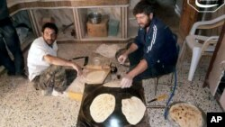 Syrian rebels make bread in the town of Qusair, Homs province, Syria. The UN is stepping up food deliveries in Syria ahead of the early July start of the Islamic holy month of Ramadan, June 3, 2013.