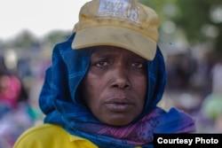 Hajja Hauwa, one of the few females in the vigilante group in Maiduguri, is in charge of security checks for women coming into Monday market, Maiduguri. (Fati Abubakar)