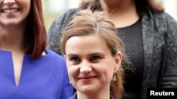 FILE - Batley and Spen MP Jo Cox is seen in Westminster, May 12, 2015.