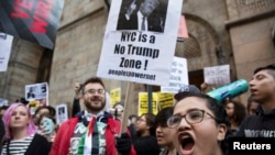 FILE - Protesters demonstrate against Republican U.S. presidential candidate Donald Trump in midtown Manhattan in New York City, April 14, 2016.