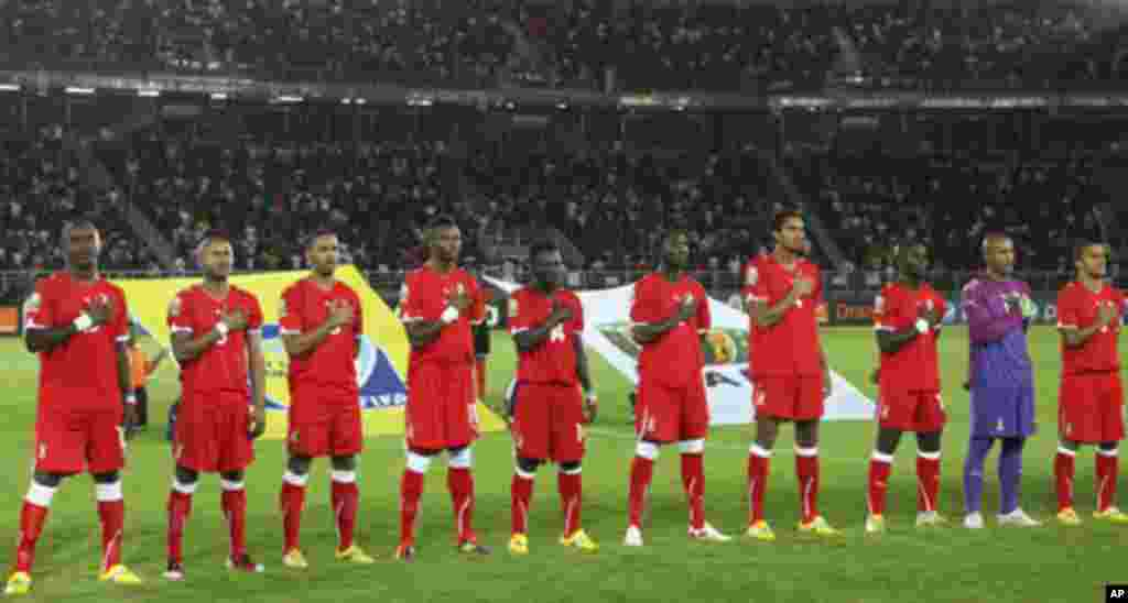 "Equatorial Guinea national soccer team players listen to their national anthem before the start of their match against Libya during the opening match at the African Nations Cup soccer tournament in Estadio de Bata ""Bata Stadium"", in Bata January 21, 2012."