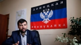 Denis Pushilin, senior member of the pro-Russia separatist rebellion leadership, meets with journalists in Donetsk, May 12, 2014.