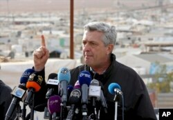 FILE - U.N. refugee chief Filippo Grandi speaks to the press during a visit to the Zaatari Syrian Refugee Camp, in Mafraq, Jordan, Feb. 12, 2018.