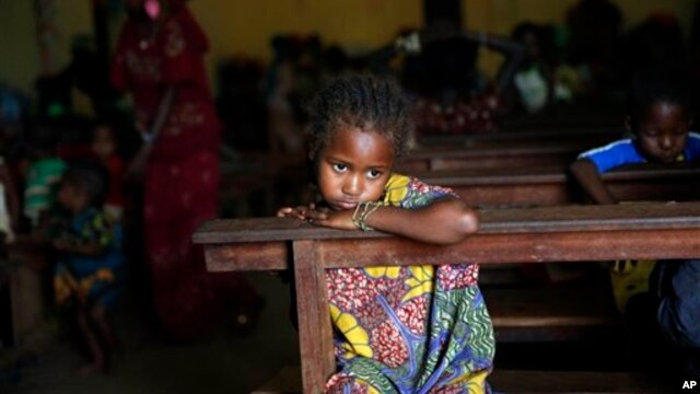 A Muslim child sits inside the St. Pierre church where she and hundreds of other Muslims are seeking refuge in Boali, Central African Republic, some 80kms (50 miles) north-west of Bangui, Thursday, Jan. 23,  2014. Clashes erupted between Anti-Balaka Chri