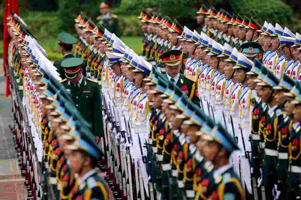Members of the honor guard prepare for the arrival of France's President Francois Hollande at the Presidential Palace in Hanoi, Vietnam.