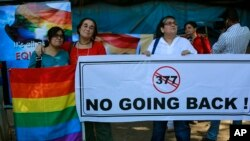 Indian activists in Mumbai protest a law banning same-sex marriage.