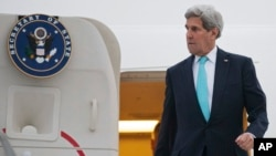FILE - U.S. Secretary of State John Kerry disembarks from plane after arriving in Geneva, Switzerland, March 15, 2015.