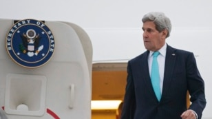 FILE - U.S. Secretary of State John Kerry disembarks from his plane as he arrives in Geneva, Switzerland, March 15, 2015.